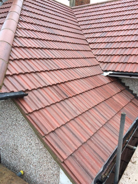 image of a red tiled roof what has just been completed